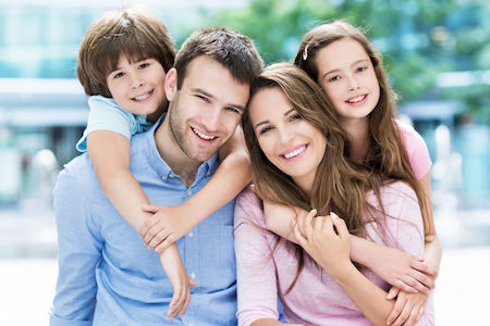 41255790 - family of four hugging each other